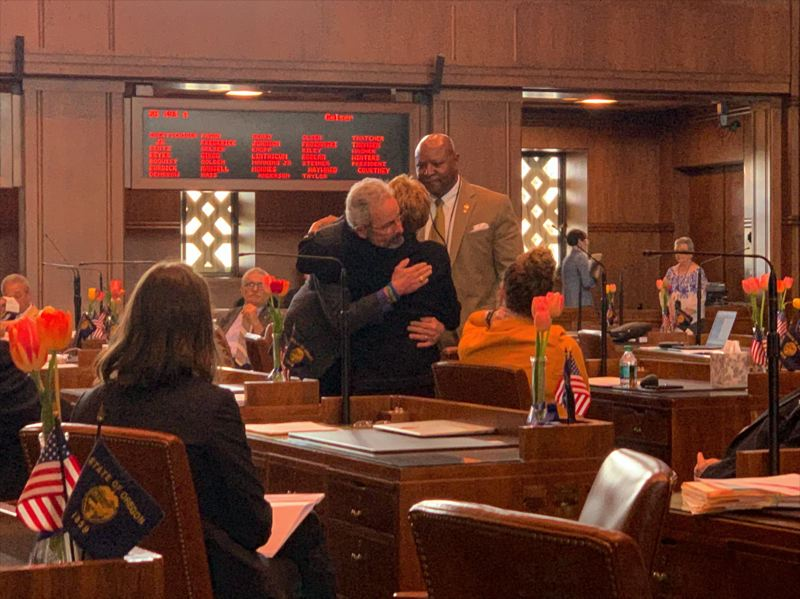 OREGON CAPITAL BUREAU PHOTO: AUBREY WIEBER - Sen. Floyd Prozanski hugs Sen. Jackie Winter after a vote on a bill to alter Measure 11 charges for juveniles. Winters carried the bill on the Senate floor.