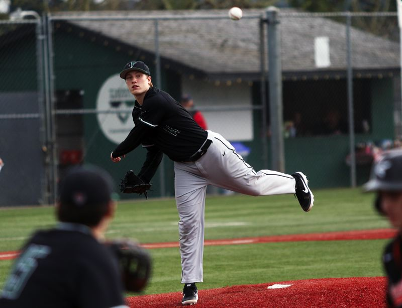 PMG PHOTO: DAN BROOD - Tigard senior pitcher Fletcher Ahl makes a throw to first on a pickoff play during the Tigers' game with Beaverton on Tuesday.