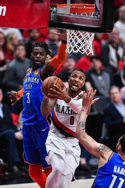 PMG PHOTO: CHRISTOPHER OERTELL - Damian Lillard goes to the basket for the Trail Blazers as they down the Oklahoma City Thunder 114-94 at Moda Center on Tuesday. Portland takes a 2-0 lead to OKC in the teams' NBA best-of-seven first-round playoff series.
