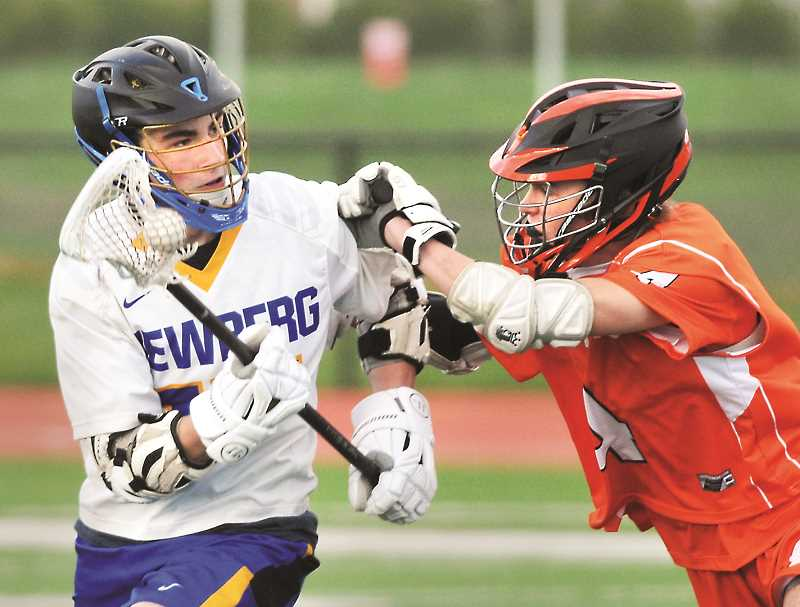 GRAPHIC PHOTO: GARY ALLEN  - Junior Mitchell Mendonsa looks for an open teammate in the Tigers' game against Sprague last week.
