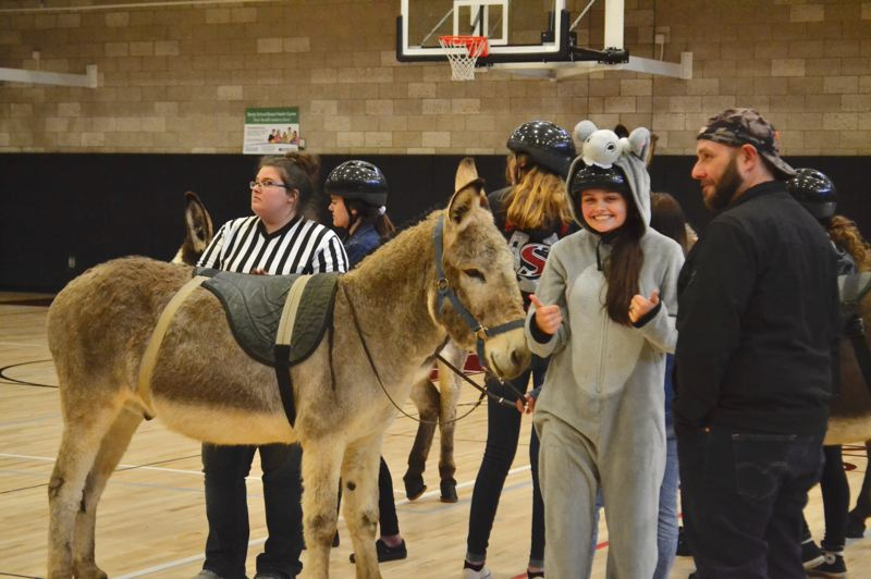 POST PHOTO: BRITTANY ALLEN - Some teams took their uniform choices more seriously than others at the annual donkey basketball game on April 12.