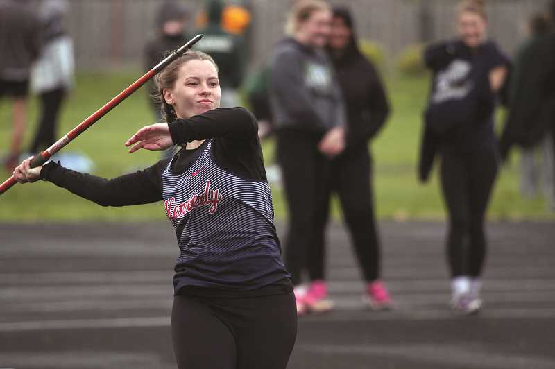 PMG PHOTO: PHIL HAWKINS - Kennedy senior Caitlyn Kleinschmit won the javelin event with a throw of 99-02, one of 10 victories for the Trojans at Gervais.