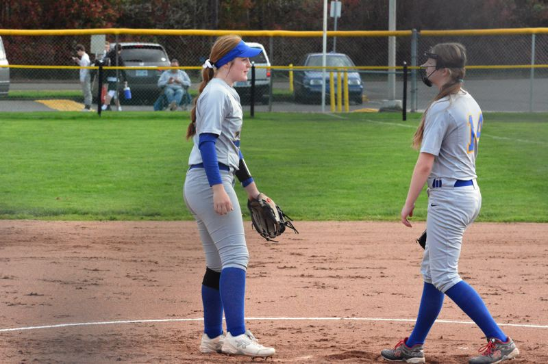 TIMES PHOTO: MATT SINGLEDECKER - Aloha senior Emily Churchill made a number of defensive stops and picked up RBIs against Mountainside.