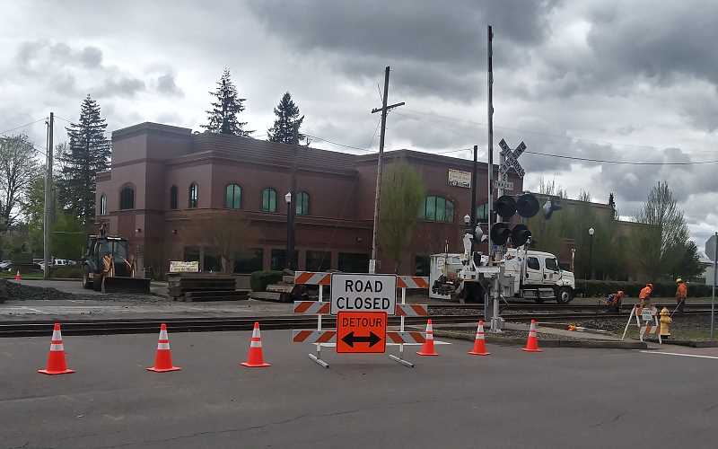 PMG PHOTO: JUSTIN MUCH - Union Pacific crews work on the tracks near Lincoln Street in downtown Woodburn