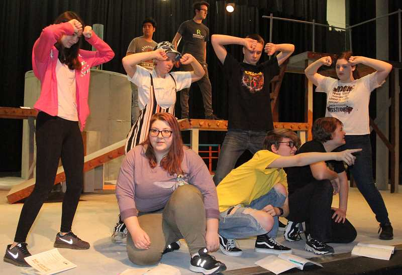 PMG PHOTO: JUSTIN MUCH - Woodburn High School Theater cast for Peter and the Starcatcher, which premieres Friday, April 26: Background: Sam Torres (Smee), Conner Williams (Black Stache); Standing: Jayna Moore (Mollusk), Ari Macrum (Fighting Prawn), Caleb Larson (Lord Aster), Andra Pascalar (Hawking Clam); Kneeling: Jasmine Chapman-Macrum (Prentiss), Dallon Jensen (Boy), Elowyn Haneberg (Ted)