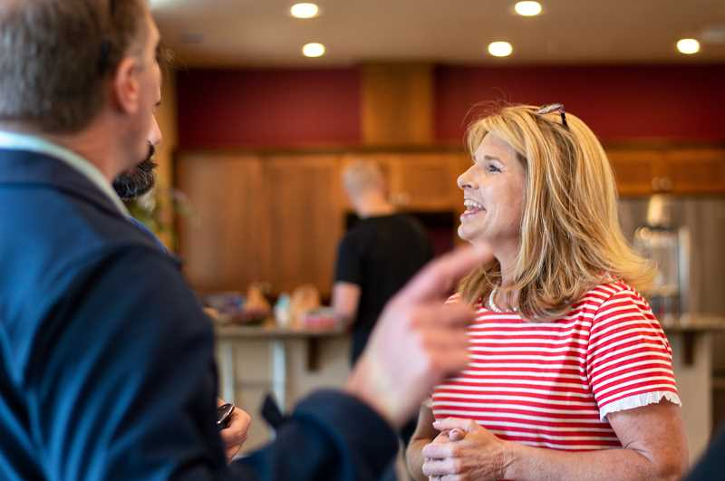PMG PHOTO: CLARA HOWELL  - Christy Thompson chats with local community members.
