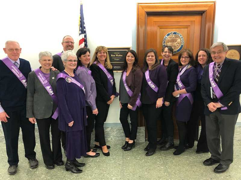 The delegation of Alzheimers Association advocates pose outside Ron Wydens office in Washington D.C.