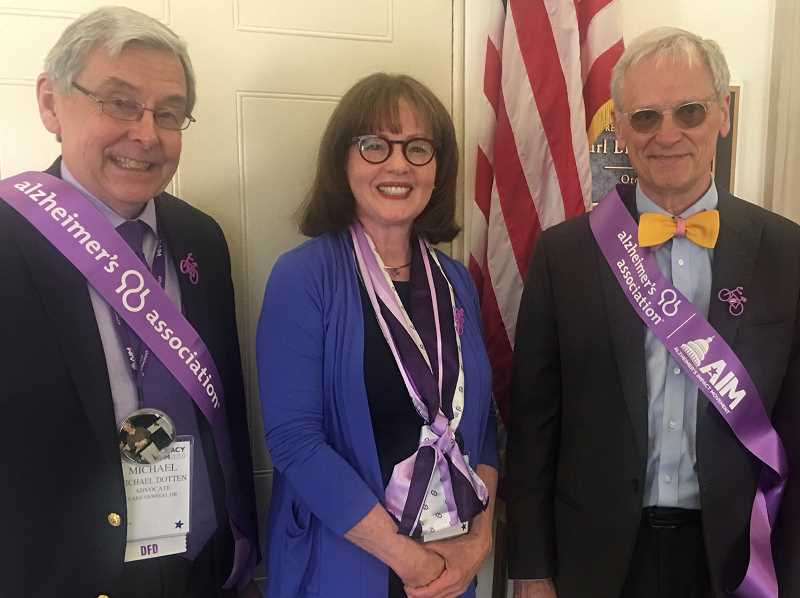 Mike and Cheryl Dotten of Lake Oswego pose with Rep. Earl Blumenauer, who cosponsored the Improving HOPE for Alzheimers Act.