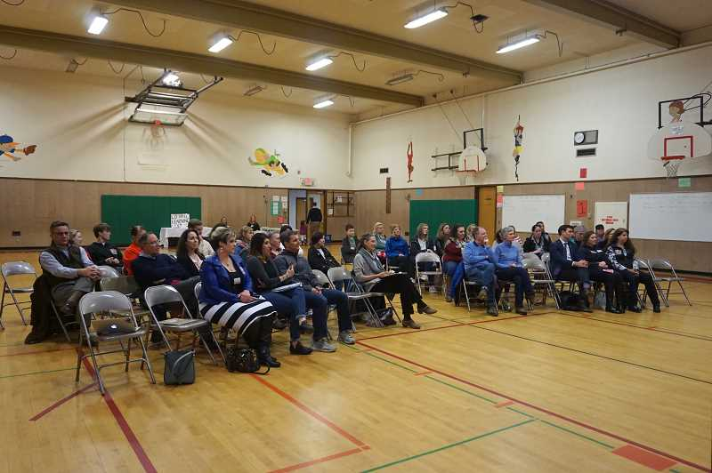 PMG PHOTO: CLAIRE HOLLEY - Community members gathered at River Grove Elementary to hear from the candidates.