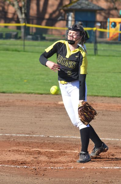 COURTESY PHOTO: JOHN BREWINGTON - Brea Paulson pitches for St. Helens on Wednesday as the Lions nail down a 7-2 league softball victory over visiting Scappoose.