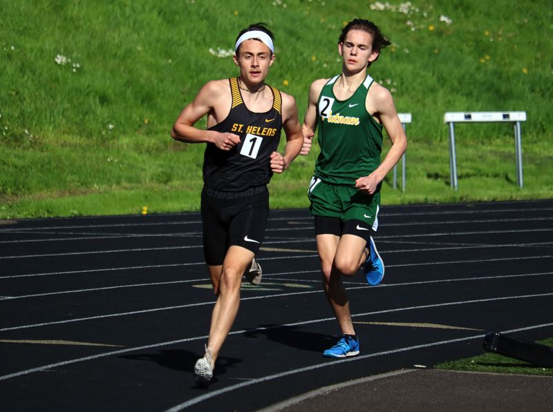 PMG PHOTO: JIM BESEDA - Waylon Nichols of St. Helens High heads to a victory in the 1,500 over Grant Ferguson of host Putnam in a three-team league meet on Wednesday.