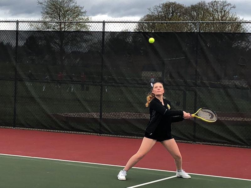 PMG PHOTO: STEVE BRANDON - St. Helens High's Annabelle Robitz prepares to strike a backhand during a doubles match against Milwaukie.