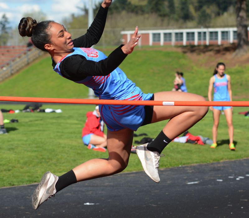 PMG PHOTO: DAVID BALL - Centennials Heata Fononga works to get over the bar during her second-place finish in the high jump during Wednesdays home meet.