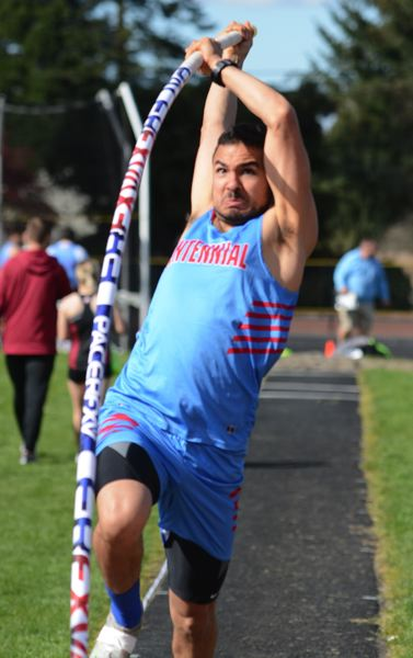 PMG PHOTO: DAVID BALL - Centennials Mario Zaki bends his pole on his way to second place in the pole vault. The Eagles swept the top three spots in the event.