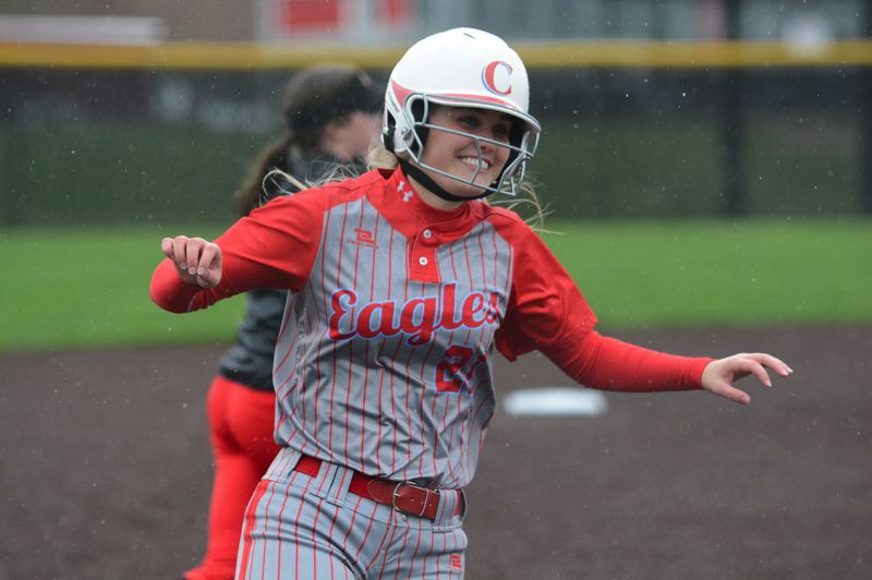 PMG PHOTO: DAVID BALL - Mia Bratcher is all smiles rounding third base after hitting a lead-off home run in the second inning of the Eagles 12-9 win at Clackamas on Monday.