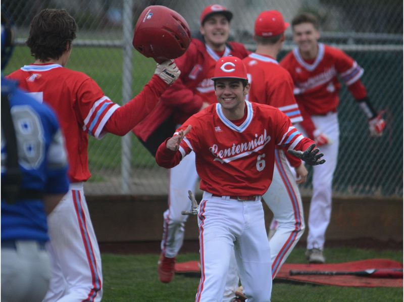 PMG PHOTO: DAVID BALL - Centennials Dillon Hart rushes to meet Kyle Fitzgerald after he crossed home plate off Landan Ferys walk-off double in Tuesdays 8-7 win over Gresham.