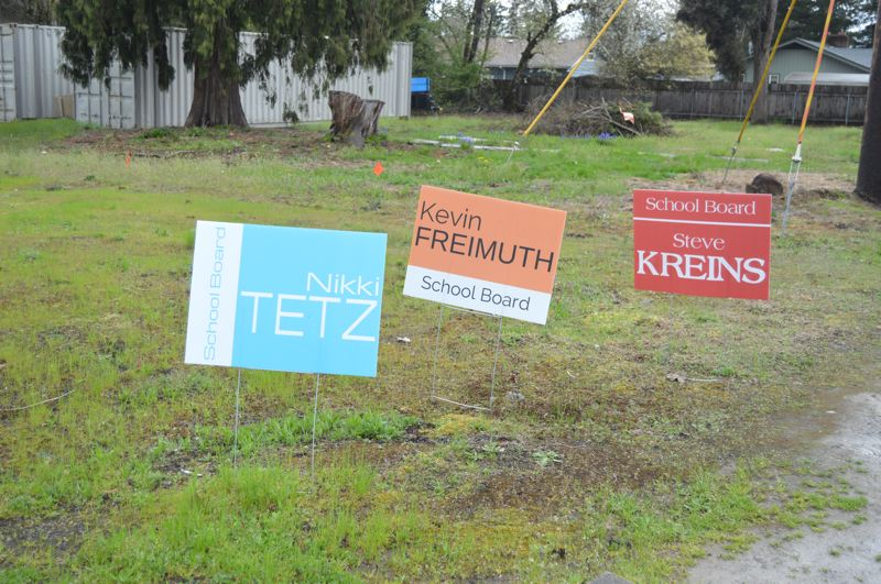 PMG PHOTO: NICOLE THILL-PACHECO - A series of campaign signs for school board newcomers Kevin Freimuth, Steve Kreins and Nikki Tetz appear in the yard of a Scappoose resident. Despite the proximity, the trio say they are not running in a block, but are supportive of one another in their campaigns for positions on the Scappoose School Board.