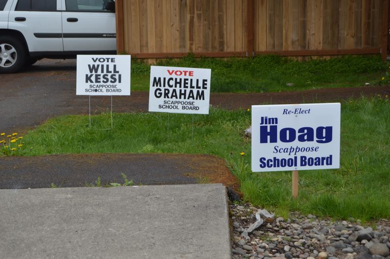 PMG PHOTO: NICOLE THILL-PACHECO - A series of campaign signs for incumbent school board members Michelle Graham, Jim Hoag and Will Kessi appear in the yard of a Scappoose resident.