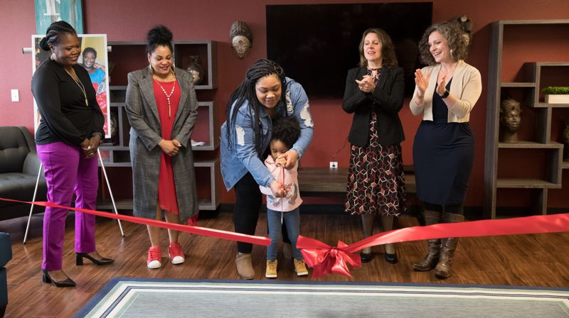 COURTESY PHOTO: MULTNOMAH COUNTY  - Journey Ioane cuts the ribbon to celebrate the opening of Diane Wade House on Wednesday, April 10.  Also pictured are Erika Preuitt, ONesha Cochran, Alexandria Ioane, Multnomah County Chair Deborah Kafoury and Abbey Stamp.