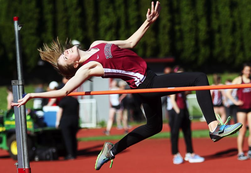 PMG PHOTO: DAN BROOD - Sherwood High School sophomore Samantha Christensen looks to get over the bar during the high jump event in the meet at Glencoe.