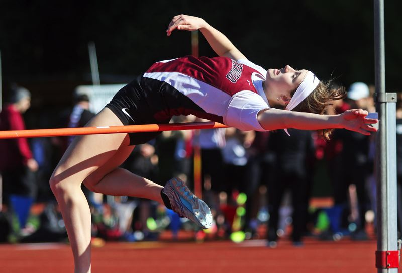 PMG PHOTO: DAN BROOD - Sherwood High School sophomore Joley Sproul looks to get over the bar during the high jump event in the meet at Glencoe.