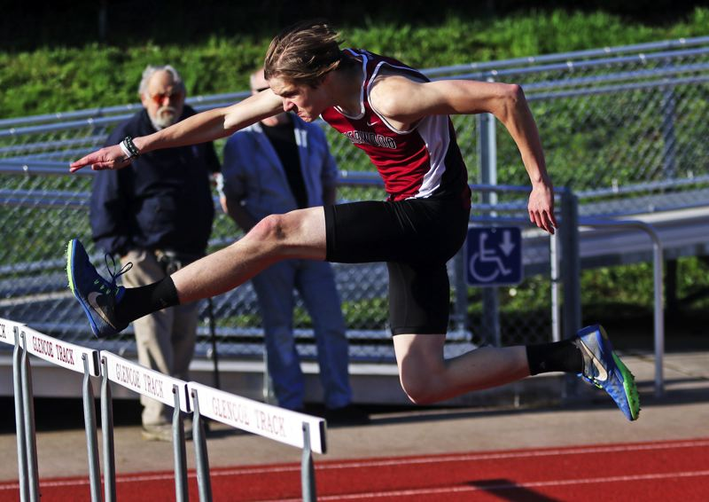 PMG PHOTO: DAN BROOD - Sherwood High School senior Dylan Blue is on his way to victory in the 110-meter high hurdles during the Pacific Conference meet at Glencoe.