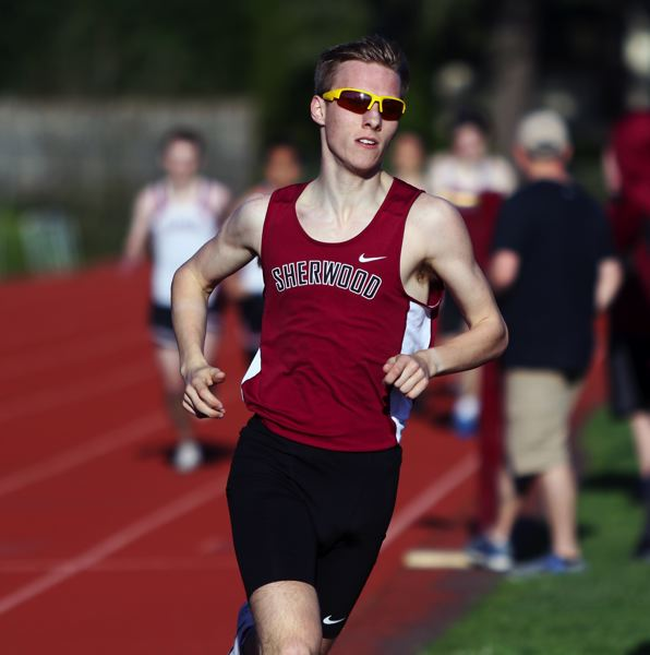 PMG PHOTO: DAN BROOD - Sherwood High School junior Thomas Osborne ran to victory in the 800-meter run during the Pacific Conference meet at Glencoe.