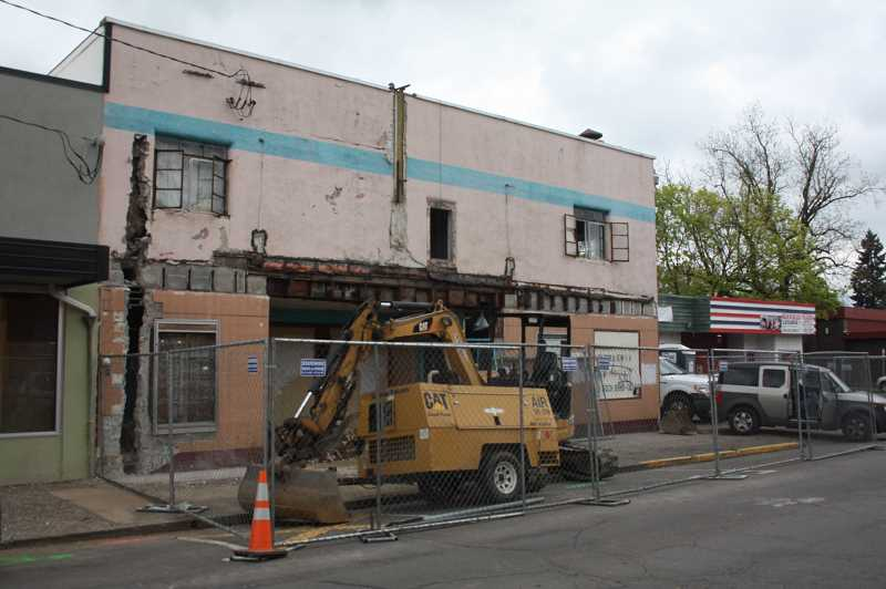PMG PHOTO: JUSTIN MUCH - Demolition of the former Pix Theater building has begun this month, a project thats timing coincides with First Street Improvements.