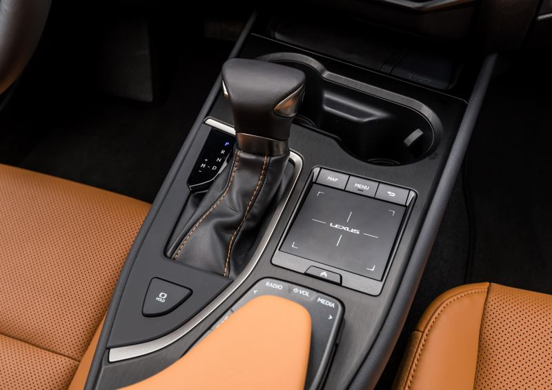 TOYOTA MOTOR SALES - The stereo controls on the center console are easy to understand and use, but the touchpad takes a little practice in the 2019 Lexus UX 200 F Sport.
