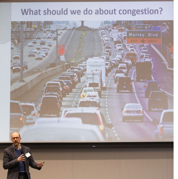 PHOTO BY JAIME VALDEZ - Eliot Rose from Metro offers his plan for congestion at the Greater Portland Tech Challenge at Daimler Trucks North America LLC in North Portland.