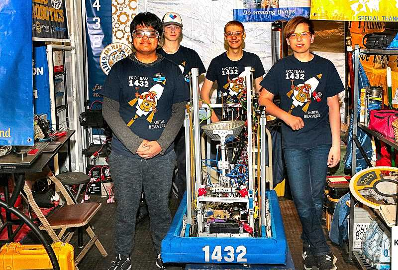 DAVID F. ASHTON - In their pit, FIRST Robotics Competition Team 1432, the Metal Beavers, are crew members J.R. Surban, Jacob Purvis, Nathaniel Lyons, and Ammon Corpron, getting ready for another match.