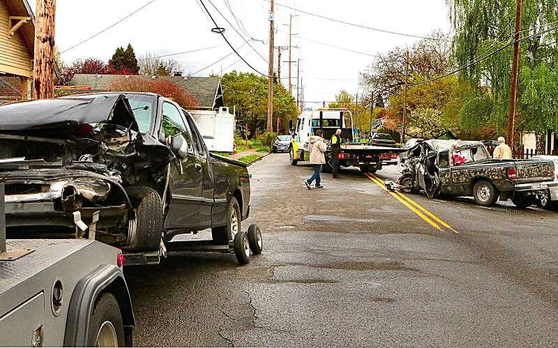 DAVID F. ASHTON - Two trucks were damaged - one severely - In a Holgate Boulevard offset head-on crash, on the border between the Woodstock and Creston-Kenilworth neighborhoods.