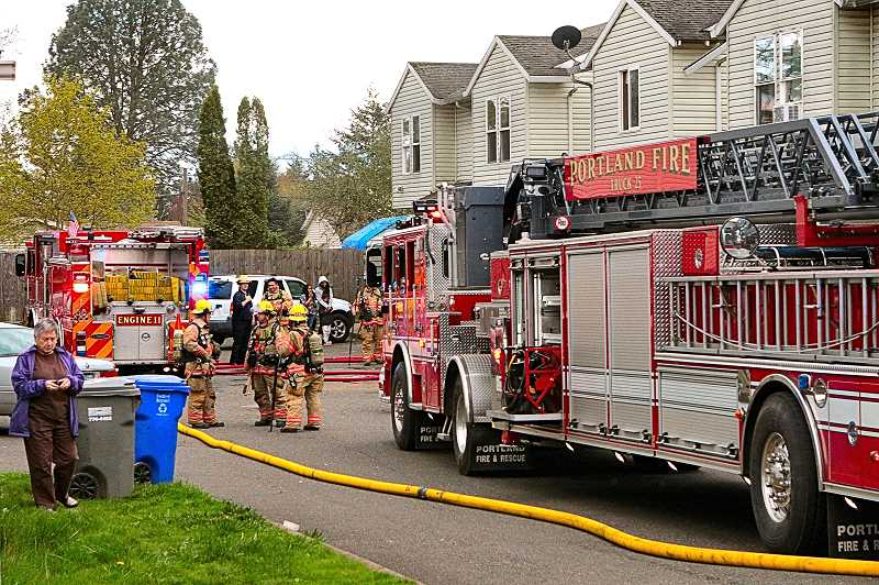 DAVID F. ASHTON - A full turn-out of firefighters and equipment limited fire damage to just one of the three townhomes.