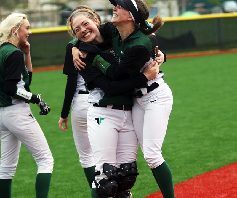PMG PHOTO: DAN BROOD - Tigard senior Maddie Hoover (right) and junior Emily Paulson are all smiles following the Tigers' 3-1 win over rival Tualatin on Saturday.