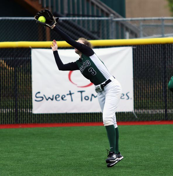 PMG PHOTO: DAN BROOD - Tigard freshman right fielder Eliot Miner makes a reaching catch during the first inning of Saturday's game.
