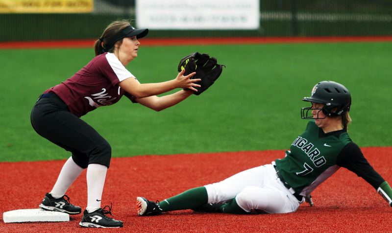 PMG PHOTO: DAN BROOD - Tualatin junior shortstop Bella Valdes (left) forces out Tigard junior Lexi Klum at second base during the first inning of Saturday's game.