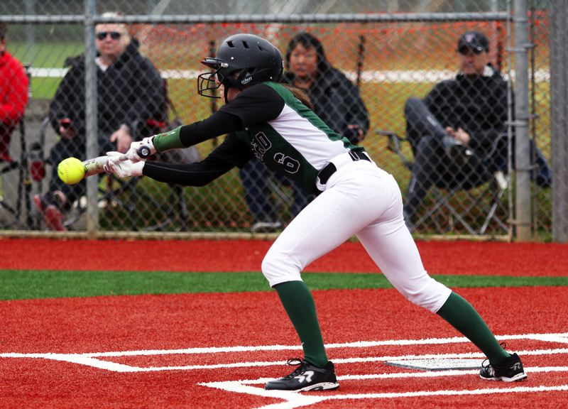 PMG PHOTO: DAN BROOD - Tigard senior Maddie Hoover puts down a bunt during the first inning of the Tigers' game with Tualatin on Saturday.