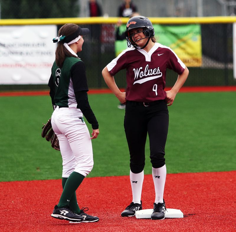 PMG PHOTO: DAN BROOD - Tualatin junior Sydney Wagner (right) talks with Tigard senior Maddie Hoover after hitting a second-inning double during Saturday's game.