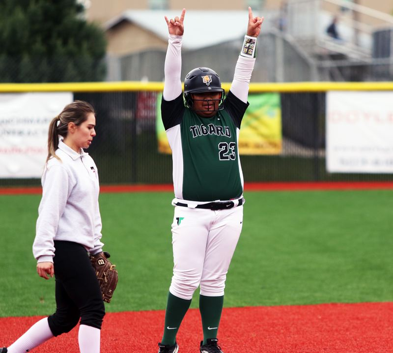 PMG PHOTO: DAN BROOD - Tigard freshman Kani Korok celebrates after hitting a fourth-inning double during the Tigers' 3-1 win over Tualatin on Saturday.
