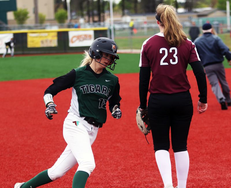 PMG PHOTO: DAN BROOD - Tigard freshman Makenna Reid rounds third base on her way to scoring the go-ahead run for the Tigers in their 3-1 victory over Tualatin on Saturday.