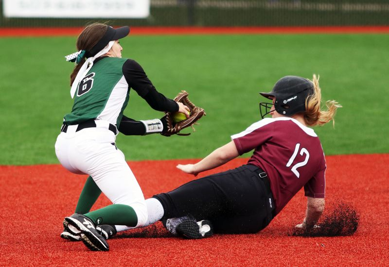 PMG PHOTO: DAN BROOD - Tigard senior shortstop Maddie Hoover (left) tags out Tualatin junior Nicole Webb on a stolen base attempt in Saturday's game.