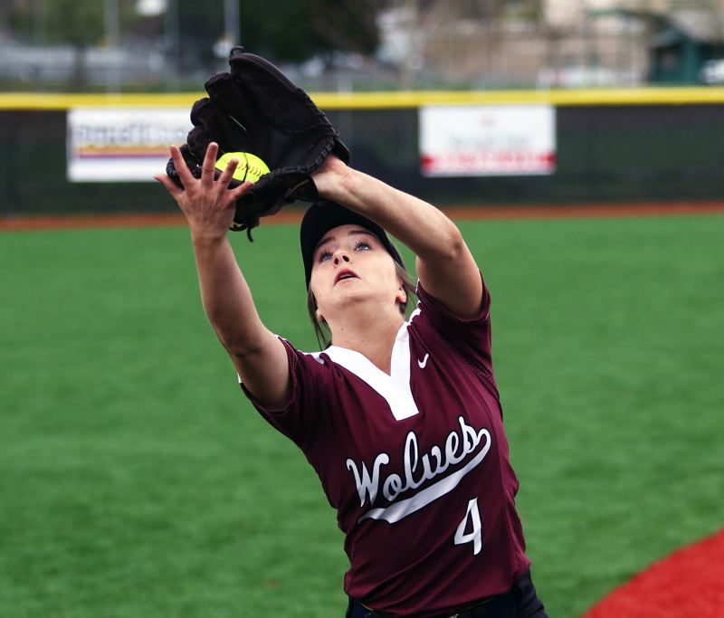 PMG PHOTO: DAN BROOD - Tualatin junior shortstop Bella Valdes catches a foul ball during Saturday's game at Tigard.