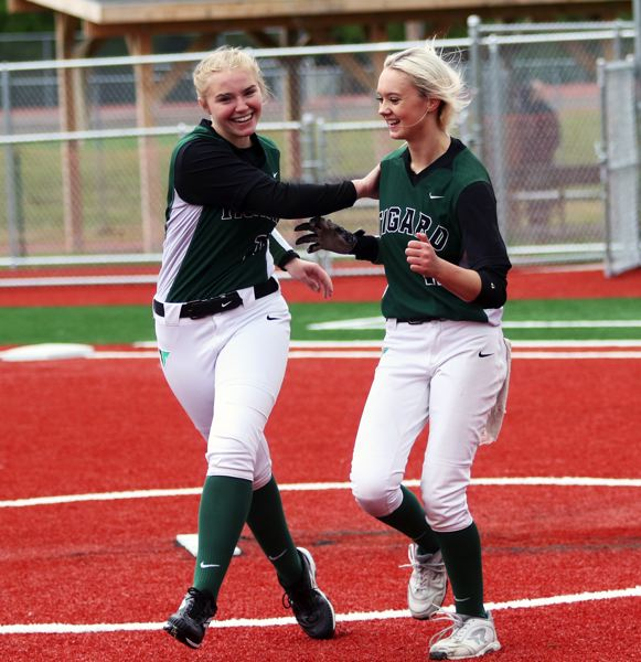 PMG PHOTO: DAN BROOD - Tigard sophomore Sophia vanderSommen (left) and freshman Makenna Reid celebrate following the Tigers' 3-1 win over Tualatin on Saturday.