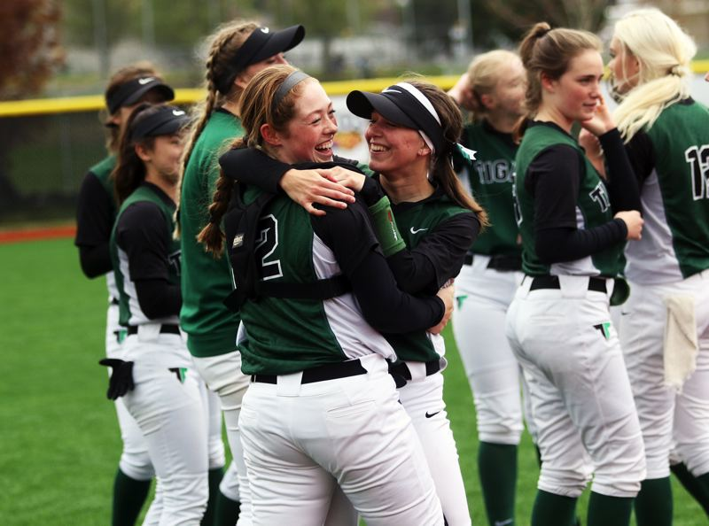 PMG PHOTO: DAN BROOD - The Tigard High School softball team celebrates after ending Tualatin's 45-game winning streak with a 3-1 victory on Saturday.
