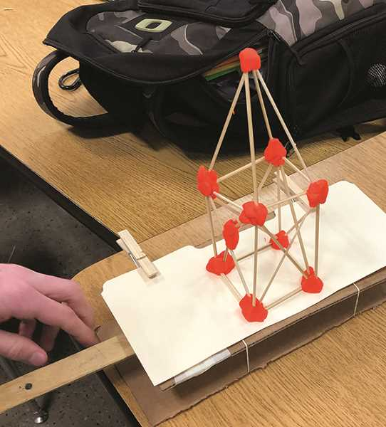 COURTESY PHOTO: RANDY DALTON - One of the students' challenges was to create structures on a shake table that could withstand shaking as in an earthquake.
