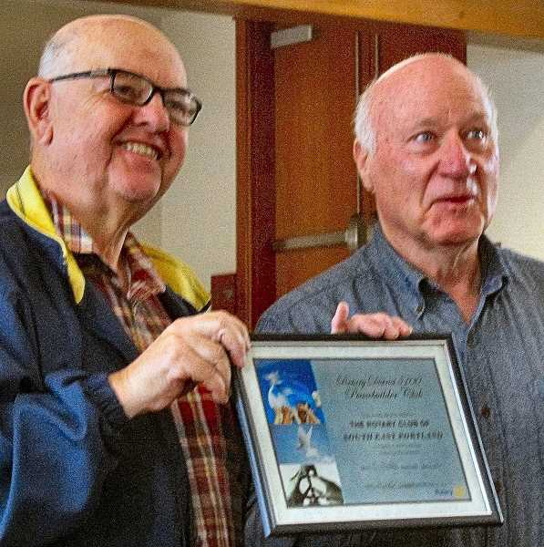 ERIC NORBERG - Past Rotary District Governor Mike Caruso, left, presented Southeast Portland Rotary its plaque officially recognizing it as a Peacebuilder Club, on April 1 in Westmoreland. Accepting for the club was its Treasurer and Past President, John Ellis.