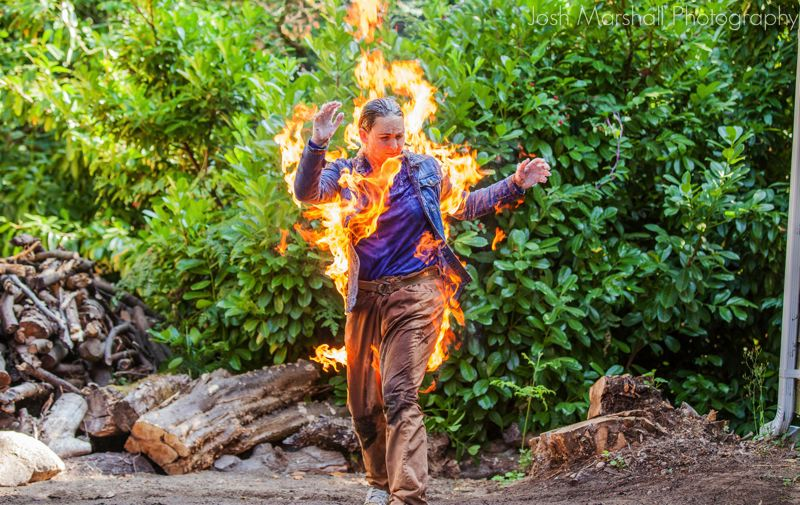 PHOTO COURTESY OF JOSH MARSHALL PHOTOGRAPHY - A student at the International Stunt School in Seattle demonstrates the correct way to safely set an actor on fire for a film or TV show.