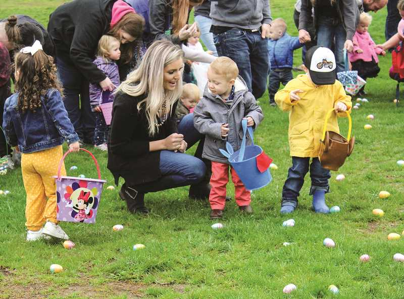 JASON CHANEY/CENTRAL OREGONIAN  - Easter Egg hunters go after the candy-filled plastic Easter eggs.