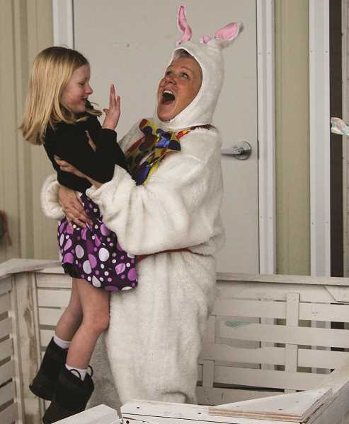 JASON CHANEY/CENTRAL OREGONIAN  - Payton Ansen visits with the Easter Bunny (Kiwanian Lou Saenz) during the event.