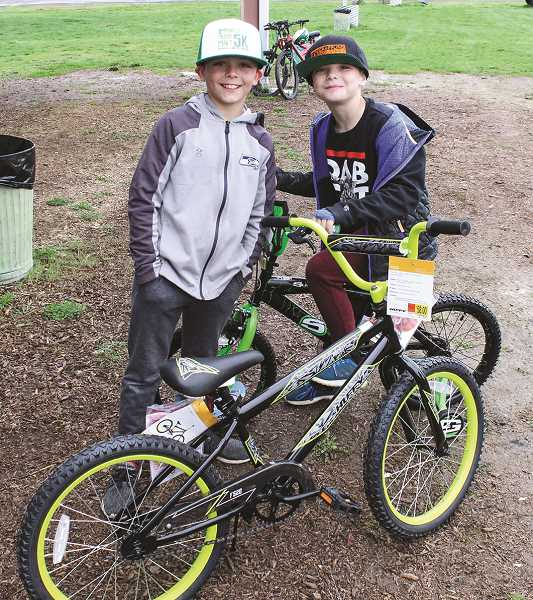 JASON CHANEY/CENTRAL OREGONIAN  - Josiah Breese, left, won a bicycle in the boys 9 to 10 age group, and his brother, Daniel Breese, won a bike in the boys 6 to 8 age group. ProLine Fabrication donated the funds for the prizes, two tricycles and six bicycles.